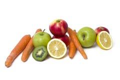 Frutas en un fondo blanco Limón con las manzanas y kiwi en el fondo blanco Kiwi con el limón en un fondo blanco Imagen de archivo libre de regalías