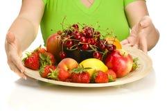 Frutas en una placa Imágenes de archivo libres de regalías