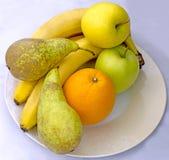 Frutas en una placa Fotos de archivo libres de regalías