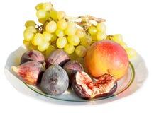 Frutas estacionales del otoño en aislante de la placa Foto de archivo libre de regalías