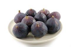 Frutas maduras de um figo no branco Imagens de Stock