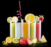 Frutas sabrosas del verano con el jugo en vidrio Fotografía de archivo libre de regalías