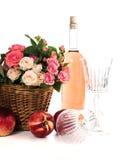 Frutas, vino y flores Imagen de archivo