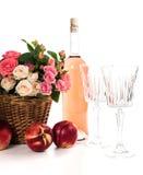 Frutas, vino y flores Fotos de archivo