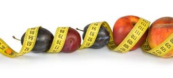 Frutas y centímetros Fotografía de archivo libre de regalías