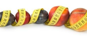Frutas y centímetros de primer Imagenes de archivo