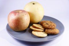 Frutas y galletas Imagenes de archivo