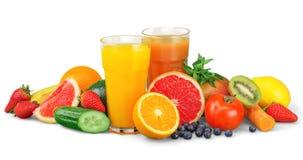 Frutas y jugo sabrosos con las vitaminas encendido imágenes de archivo libres de regalías