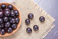 Frutas y polvo del acai Imagenes de archivo
