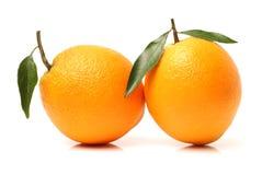 Fruto alaranjado fresco com folha imagens de stock