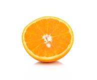 Fruto alaranjado meio no fundo branco Imagem de Stock