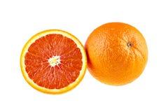 Fruto alaranjado suculento e uma metade isolada no branco Imagens de Stock Royalty Free
