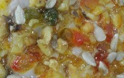 Fruto cristalizado e casca como a decoração no macro do bolo Fotos de Stock Royalty Free