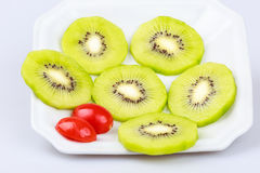 Fruto de quivi fresco delicioso da fatia no fundo branco Imagens de Stock