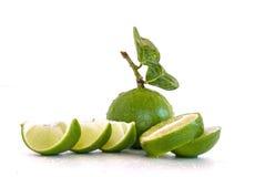 Fruto do limão do cal com uma metade isolado Fotografia de Stock Royalty Free