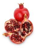 Fruto maduro da romã isolado no entalhe branco do fundo Foto de Stock