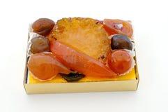 Frutos cristalizados na caixa Fotos de Stock Royalty Free