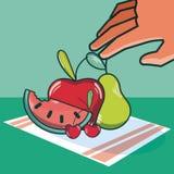 Frutos de agarramento da mão ilustração do vetor