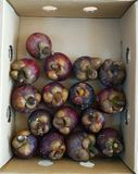 Frutos do mangustão no suporte no supermercado Imagens de Stock