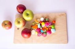 Frutos e doces Imagens de Stock Royalty Free