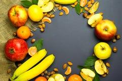 Frutos em um fundo azul Fotografia de Stock Royalty Free