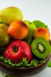 Frutos em um fundo branco Fotos de Stock
