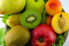 Frutos em um fundo branco Fotografia de Stock