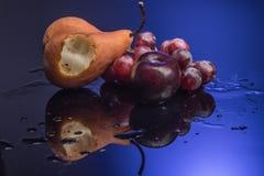 Frutos no azul Fotografia de Stock Royalty Free