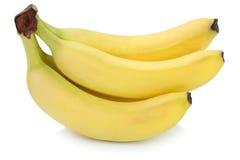 Frutos orgânicos da banana das bananas isolados no branco Fotografia de Stock