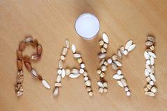 Frutos secos sob a forma da palavra, raki Fotografia de Stock Royalty Free