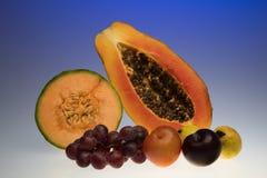 Frutos tropicais no azul Fotografia de Stock Royalty Free