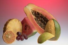 Frutos tropicais no vermelho Fotos de Stock