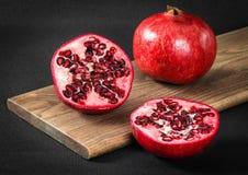 Frutta affettata del melograno Immagini Stock
