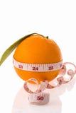 Frutta arancio e nastro di misurazione Fotografia Stock