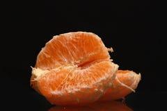 Frutta arancio isolata sul nero Immagine Stock Libera da Diritti