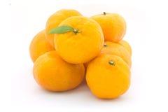 Frutta arancio su bianco Fotografia Stock