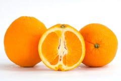 Frutta arancione affettata Immagini Stock Libere da Diritti