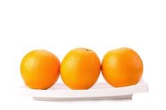 Frutta arancione isolata su bianco Fotografia Stock