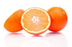 frutta arancione su una priorità bassa bianca Fotografia Stock Libera da Diritti