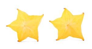Frutta decorativa della carambola del taglio con una sezione trasversale a forma di stella, isolata su un fondo bianco Carambola  Immagini Stock