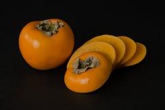 Frutta del cachi con le fette Fotografia Stock