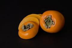 Frutta del cachi con le fette Immagini Stock