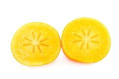 Frutta del cachi tagliata dentro a metà fotografie stock