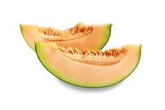 Frutta del melone delle fette isolata su fondo bianco Immagine Stock