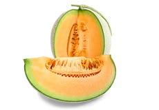 Frutta del melone delle fette isolata sui precedenti bianchi Fotografia Stock