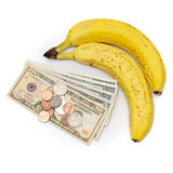 Frutta della banana con soldi Fotografie Stock