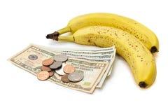 Frutta della banana con soldi Fotografia Stock Libera da Diritti