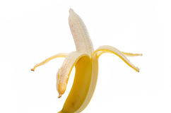 Frutta della banana senza una buccia su un fondo bianco Immagine Stock Libera da Diritti