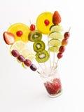 Frutta di colore su vetro Fotografia Stock
