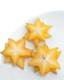 Frutta di stella fresca su priorità bassa bianca Fotografia Stock